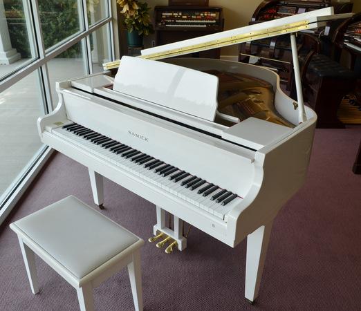 White Samick Baby Grand Piano