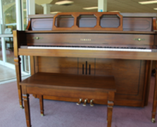 Dark walnut Yamaha console piano