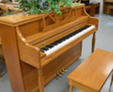 Story & Clark oak console piano (sorry, plant not included)