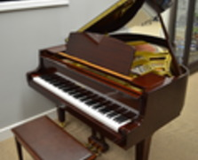 Polished mahogany Yamaha baby grand