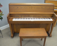 Super clean, dark oak Kawai studio piano
